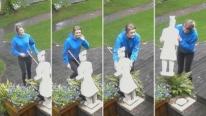 Surveillance footage from Tuesday, June 20, 2017, posted on Facebook, shows a woman in a blue sweater taking a decorative statue from a front yard in Forest Heights.