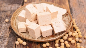 New research has found that women who consume a larger amount of vegetable protein, such as tofu, have a lower risk of early menopause. (margouillatphotos / Istock.com)