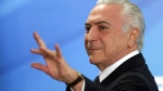 Brazil's President Michel Temer waves as he exits after attending a ceremony at the Planalto Presidential Palace, in Brasilia, Monday, June 26, 2017.  (AP Photo/Eraldo Peres)