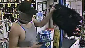 Police said a man went into the Clandeboye, Man. business on June 23 wearing a baseball cap and a neck-warmer over his face. (Source: Manitoba RCMP)