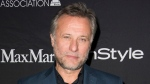 In this 2015 file photo, Swedish actor Michael Nyqvist attends The Hollywood Foreign Press Association (HFPA) and InStyle's annual Toronto International Film Festival celebration. (Photo by Arthur Mola/Invision/AP, File)