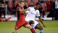 Toronto FC forward Sebastian Giovinco (10) and Montreal Impact midfielder Patrice Bernier (8) vie for control of the ball during second half Canadian Championship soccer action in Toronto on Tuesday, June 27, 2017. THE CANADIAN PRESS/Nathan Denette