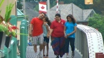 Doris and Gabriel Chordekar walk with their daughters in Port Stanley, Ont.