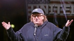 In this Thursday, Jan. 19, 2017, filmmaker Michael Moore speaks to thousands of people at an anti-Trump rally and protest in front of the Trump International Hotel in New York. (AP Photo/Kathy Willens, File)