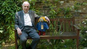 In this Thursday, June 5, 2008 file photo, British author Michael Bond sits with a Paddington Bear toy during an interview with The Associated Press in London. (AP Photo/Sang Tan, File)