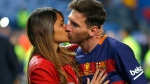 Barcelona's Lionel Messi, kisses Antonella Roccuzzo as they celebrate after winning the final of the Copa del Rey soccer match between FC Barcelona and Sevilla FC at the Vicente Calderon stadium in Madrid in this Sunday, May 22, 2016 file photo. (File/THE ASSOCIATED PRESS)