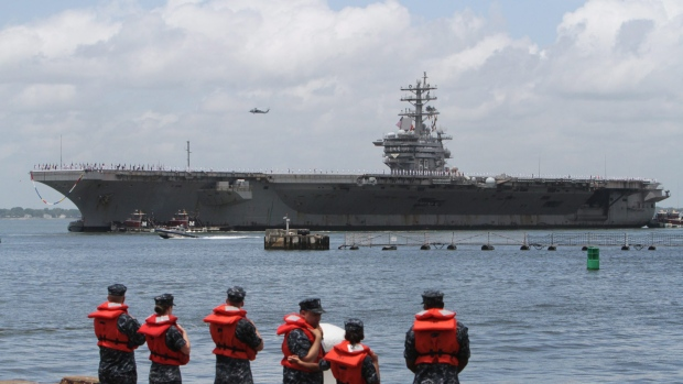 This file photo shows the USS Dwight D. Eisenhower returning to Norfolk Naval Station, Va. on Wednesday, July 3, 2013. (AP Photo/The Virginian-Pilot, Steve Earley)