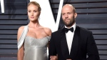 Rosie Huntington-Whiteley, left, and Jason Statham arrive at the Vanity Fair Oscar Party in Beverly Hills, Calif. on Feb. 26, 2017. (Evan Agostini/Invision/AP)