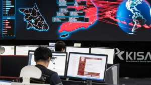 Employees watch electronic boards to monitor possible ransomware cyberattacks at the Korea Internet and Security Agency in Seoul, South Korea in this Monday, May 15, 2017 file photo. (File/Yonhap via AP)