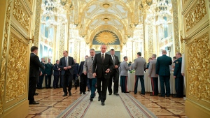 Russian President Vladimir Putin, front, followed by Defence Minister Sergei Shoigu, left, attends a meeting with graduates of military and police academies in the Kremlin in Moscow, Russia, Wednesday, June 28, 2017. (Alexei Druzhinin/Sputnik, Kremlin Pool Photo via AP)