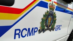 A 55-year-old woman was operating a tractor in her yard when it flipped and landed on her, RCMP said.