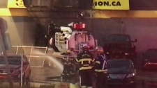 Fire erupts after stolen truck crashes into buildi