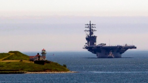 The aircraft carrier USS Dwight D. Eisenhower arrives in Halifax, Wednesday, June 28, 2017. (THE CANADIAN PRESS/Stringer)