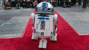 Star Wars' movie character R2-D2 is seen wearing a black bow tie as it glides down the red carpet in Los Angeles Thursday, Dec. 17, 2015. (AP Photo / Damian Dovarganes)