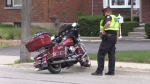 A motorcyclist had to drop his bike to the pavement in order to avoid a collision on June 28, 2017.