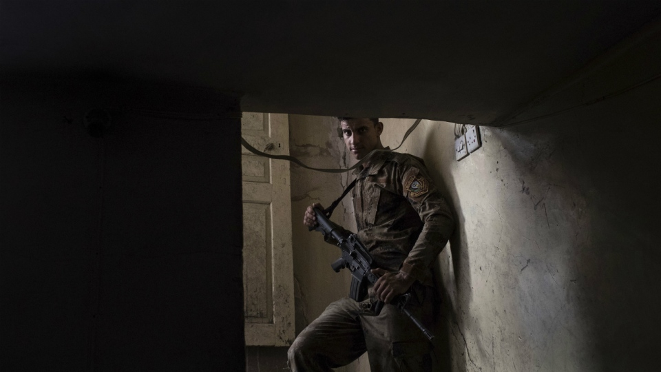 An Iraqi special forces soldier stands in a house near the frontline during fighting with Islamic State militants in the Old City of Mosul, Iraq on Wednesday, June 28, 2017. (AP / Felipe Dana)