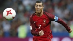 Portugal's Cristiano Ronaldo keeps his eyes on the ball during the Confederations Cup, semifinal soccer match between Portugal and Chile, at the Kazan Arena, Russia on Wednesday, June 28, 2017. (AP / Pavel Golovkin)