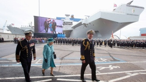 Queen Elizabeth II, second left and the Duke of Edinbugh, left, arrive for the naming ceremony of the HMS Queen Elizabeth, in Rosyth Dockyard in Fife, Scotland, on July 4, 2014. (AP / PA / Andrew Milligan)