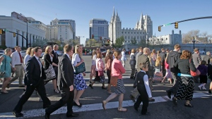 In this April 4, 2015, file photo, Mormon women wear dresses on their way to the religion's twice-yearly conference in Salt Lake City. (AP Photo/Rick Bowmer, File)