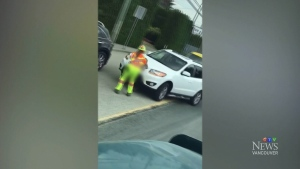 Amateur video shows a traffic controller being struck by a white SUV