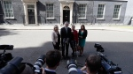 President of Sinn Fein Gerry Adams, centre left, and leader of Sinn Fein in Northern Ireland Michelle O'Neill, left, speak to the press following a meeting with Britain's Prime Minister Theresa May at 10 Downing Street in London, on June 15, 2017. (Tim Ireland / AP)