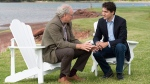 Prime Minister Justin Trudeau and Premier Wade MacLauchlan in Cardigan, P.E.I. on June 29, 2017. (Andrew Vaughan / THE CANADIAN PRESS)