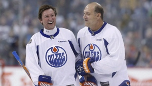 Former Edmonton Oilers Wayne Gretzky, left, and Dave Semenko joke around during a practice for the NHL's Heritage Classic Alumni game in Winnipeg on Friday, October 21, 2016. (John Woods / THE CANADIAN PRESS)
