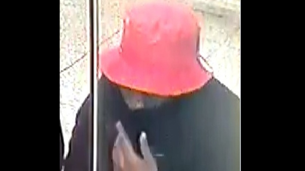 A suspect wanted in relation to the June 18 robbery of a collector at a fare booth at Woodbine Station is shown. (TPS)