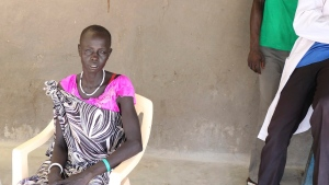 In this photo of Wednesday June 28 2017, Nyathak Eup sits outside a cholera clinic Pieri South Sudan, recounting the day she lost her daughter. (Sam Mednick/AP)