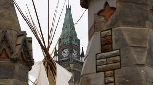 A large teepee erected by Indigenous demonstrators to kick off a four-day Canada Day protest stands in front of Parliament Hill in Ottawa on Thursday, June 29, 2017. THE CANADIAN PRESS/Justin Tang