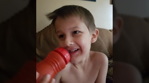 Jessica Szucki's six-year-old son, Dryden, is shown drinking from his sippy cup. (Jessica Szucki / Facebook)