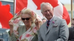 Prince Charles and Camilla, the Duchess of Cornwall, look on after arriving in Iqaluit, Nunavut, Thursday, June 29, 2017. (THE CANADIAN PRESS/Adrian Wyld)