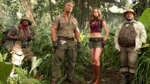 In this image released by Sony Pictures shows, from left, Kevin Hart, Dwayne Johnson, Karen Gillan and Jack Black from the film, 'Jumanji: Welcome to the Jungle,' in theaters Dec. 20. (Frank Masi / Sony Pictures via AP)