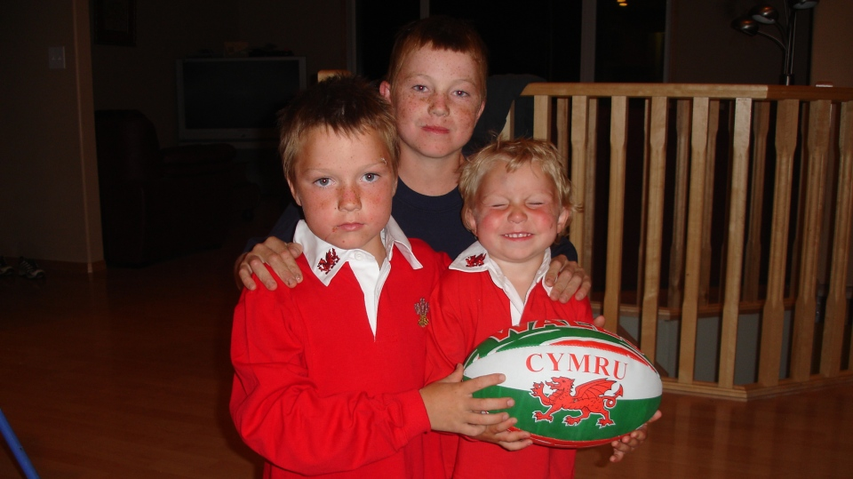 Sean, Blake and Lyndon Arnal pose with a rugby ball in this undated family photo. (SUBMITTED/ARNAL FAMILY)