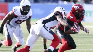 Calgary Stampeders' Terry Williams is tackled by Ottawa Redblacks' Jonathan Rose (9) in first quarter CFL action in Calgary on Thursday, June 29, 2017. (Mike Ridewood / THE CANADIAN PRESS)