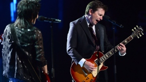 Michael J. Fox, right, performs onstage with Joan Jett during the Governor General's Performing Arts Awards gala at Rideau Hall in Ottawa on Thursday, June 29, 2017. (Sean Kilpatrick / THE CANADIAN PRESS)