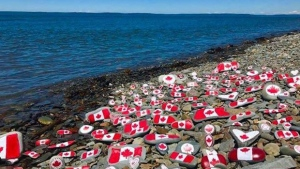 Angela Whiteley hand painted more than 150 rocks at her local beach at Gilbert's Cove in Digby County NS.  Truly Canadian!