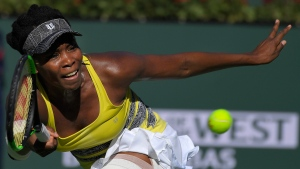 In this March 13, 2017, file photo, Venus Williams returns a shot to Lucie Safarova at the BNP Paribas Open tennis tournament. (AP Photo/Mark J. Terrill, File)