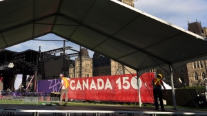 Workers prepare a stage on Parliament Hill, in preparation of the upcoming Canada Day celebrations, in Ottawa on Wednesday, June 28, 2017. (Fred Chartrand / THE CANADIAN PRESS)