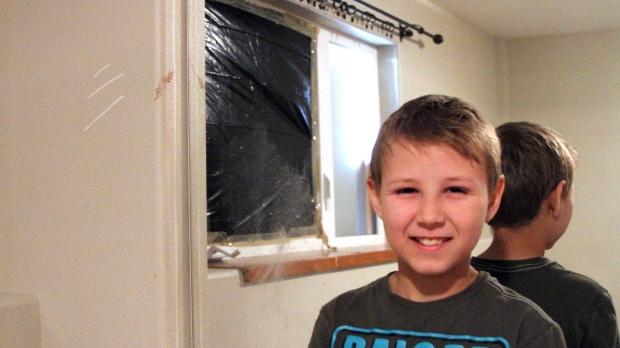Bear crashes into boy's bedroom