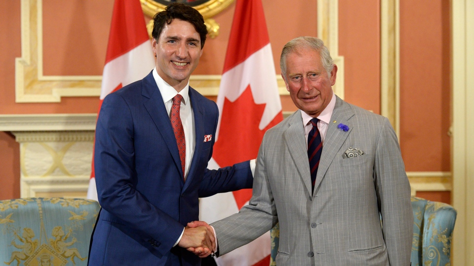 Prime Minister Justin Trudeau and Prince Charles shake hands at Rideau Hall in Ottawa on Saturday, July 1, 2017. (THE CANADIAN PRESS/Adrian Wyld)