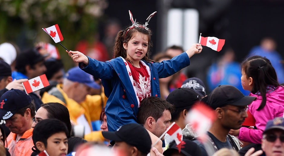 People take in the Canada 150 celebrations on Parliament Hill in Ottawa on Saturday, July 1, 2017. (THE CANADIAN PRESS/ Justin Tang)