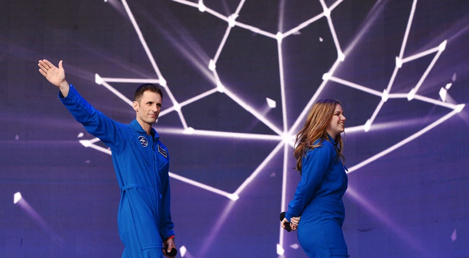 Canada's newest astronauts Joshua Kutryk and Jennifer Sidey acknowledge the crowd during Canada 150 celebrations on Parliament Hill in Ottawa on Saturday, July 1, 2017. (The Canadian Press / Sean Kilpatrick