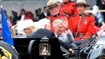 Camilla, Duchess of Cornwall, and Prince Charles ride in a carriage during Canada 150 celebrations in Ottawa on Saturday, July 1, 2017. THE CANADIAN PRESS/ Adrian Wyld