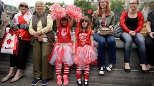 Girls of Canadian heritage who live in Banbury, England, pose for photographs during a 'Canada 150' celebration in Trafalgar Square, London, Saturday, July 1, 2017. Saturday is Canada Day, and this year marks the country's national milestone of 150 years since Confederation. (AP Photo / Matt Dunham)