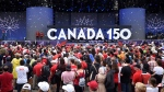 People look on during the Canada Day noon hour show on Parliament Hill in Ottawa on Saturday, July 1, 2017. THE CANADIAN PRESS/Justin Tang