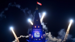 Fireworks light up behind the Peace Tower during the evening ceremonies of Canada's 150th anniversary of Confederation, in Ottawa on Saturday, July 1, 2017. (THE CANADIAN PRESS / Sean Kilpatrick)