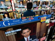 A man watches U.S. President Barack Obama on TV at an electrics shop in Tokyo's Akihabara electronics district in Tokyo, Japan, Sunday, April 5, 2009. (AP / Shizuo Kambayashi)