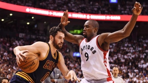 Cleveland Cavaliers forward Kevin Love (0) protects the ball from Toronto Raptors forward Serge Ibaka (9) during the second half of game three of an NBA playoff series basketball game in Toronto on Friday, May 5, 2017. (THE CANADIAN PRESS/Frank Gunn)
