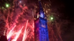 Fireworks explode over the Peace Tower during the evening ceremonies of Canada's 150th anniversary of Confederation, in Ottawa on Saturday, July 1, 2017. THE CANADIAN PRESS/Justin Tang